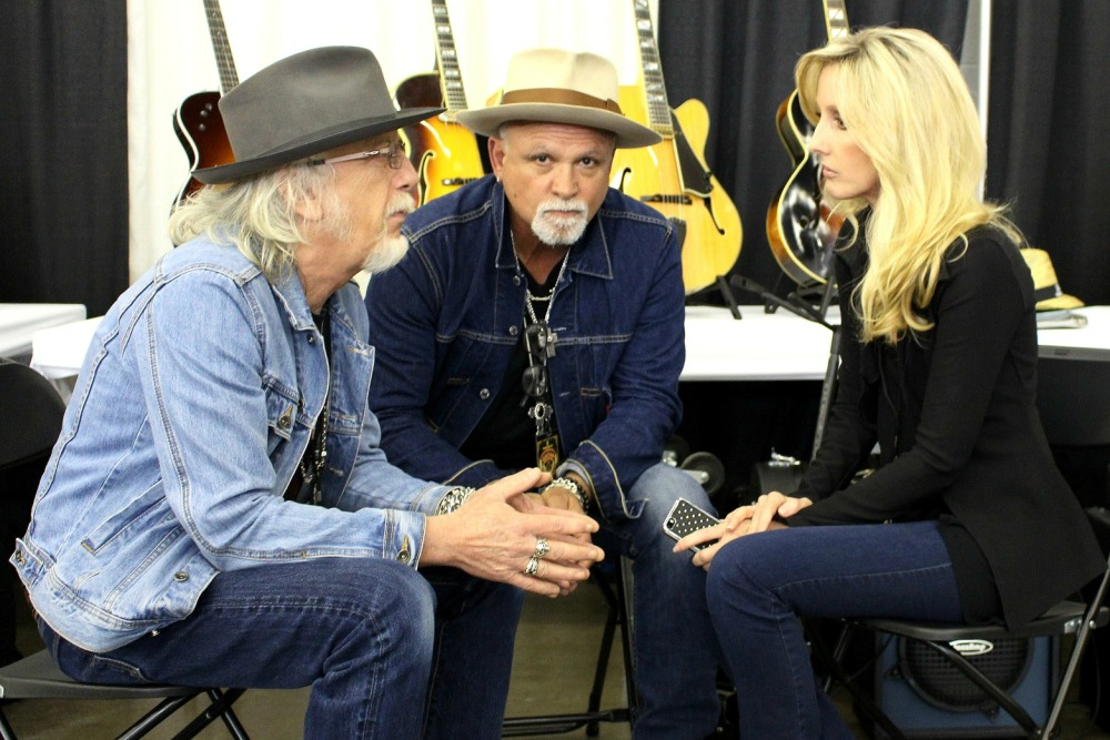Guitartists Brad Whitford and Derek St. Holmes with Sherri Tilley